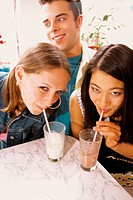 Girls drinking milkshakes