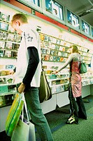 People in CD store