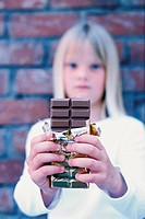Girl offering chocolate
