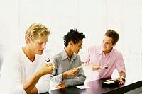 Men eating at sushi bar