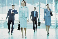 Businesspeople in airport terminal