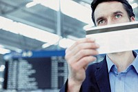 Businessman checking airline ticket