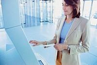 Businesswoman checking airline ticket