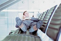 Businessman relaxing in airport lounge
