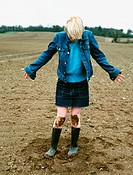 Woman looking at her muddy knees