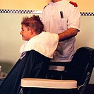 Barber drying boys hair