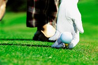 Gloved hand with golf ball