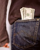 US dollars sticking out a back pocket (thumbnail)