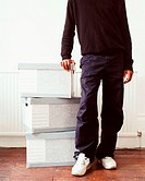 Man leaning on cardboard boxes