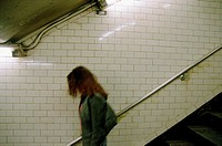 Young woman walking down stairs (thumbnail)