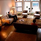 Couple sitting apart in living room (thumbnail)