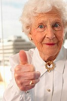 Elderly woman giving the thumbs up