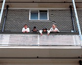 Teenagers standing on balcony
