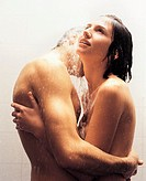 Couple With their Arms Around Each Other Standing Nude in the Shower
