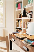 Desk, Laptop and a Lamp in a Home Office