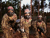 Portrait of People Paintballing Dressed in Camouflage Clothing and Wearing Face
