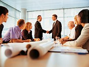 Ceo´s Shaking Hands in a Meeting Room of Business People