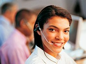 Portrait of a Young Businesswoman Wearing a Headset in An Office