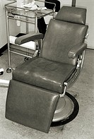 Black and white image of a dentists chair (thumbnail)