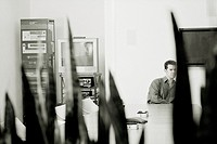 Businessman Sitting Alone in Conference Room (thumbnail)
