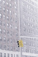 Traffic light and exterior of housing block in snow storm (thumbnail)