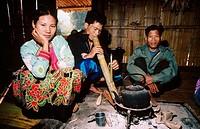 Lahu villagers smokings a bong water pipe. Near Mae Hong Son. North Thailand