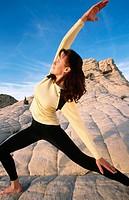 Woman practicing yoga at Snow Canyon State Park. Utah, USA