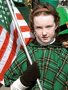 Girl at Saint Patrick´s parade holding a flag