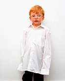 Young boy in oversized shirt