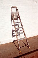 Stepladder leaning against wall