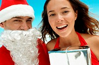 Santa and happy young woman