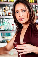 Woman standing in bar