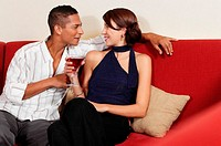 Couple drinking on sofa