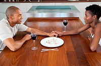 Couple sitting at dining table (thumbnail)