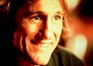 Film,´Ein Licht In Meinem Herzen´, USA 1997, Regie: Nick Cassavetes, Szene mit Gerard Depardieu  portrait,lachend,gesicht halb beleuchtet