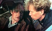 Film, ´Ein kurzer Film über das Töten´, Polen 1988,  Regie: Krzysztof Kieslowski Szene mit: Miroslaw Baka (?) und NIP  mann in auto, wunde am kopf blu...