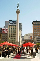 Outdoor art fair at Union Square, displayed on easels with red umbrellas. San Francisco. California, USA