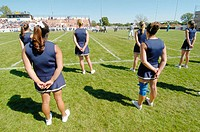 Cheerleaders performing during football game