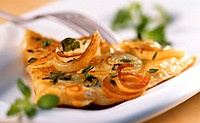 Tortilla with onions and herbs