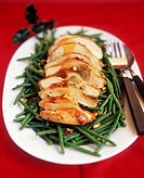 Turkey breast with pine nuts on beans