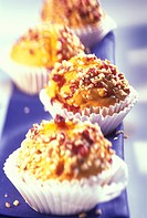 Pumpkin and cranberry muffins with nuts in paper cases