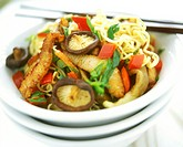 Asian noodles with mushrooms, chicken and vegetables