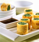 Tamgago maki: egg rolls with spinach filling and soy sauce