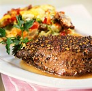Ostrich steak with vegetable gratin