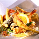 Mixed deep-fried fish (Fritto misto) with lemon