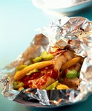 Texan red snapper fillet with vegetables cooked in foil