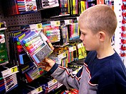 9 year old boy buying school supplies