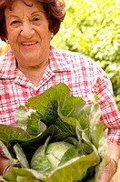Older woman with cabbage