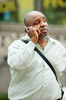 Professional black male talking on cell phone, street life. Miami. Florida, USA