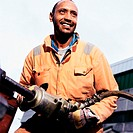 Construction worker using pneumatic drill